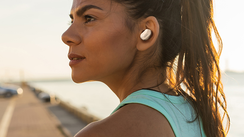 Jogger with SoundForm True Wireless Earbuds in her ear