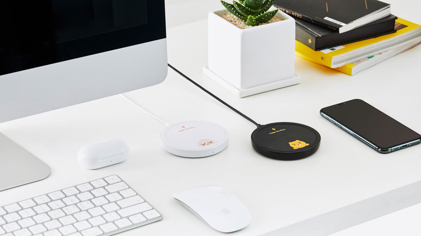 Smartphone on the BOOST↑UP Wireless Charging Pad on a desk