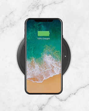 iPhone charging on the BOOST↑UP™ Wireless Charging Spot
