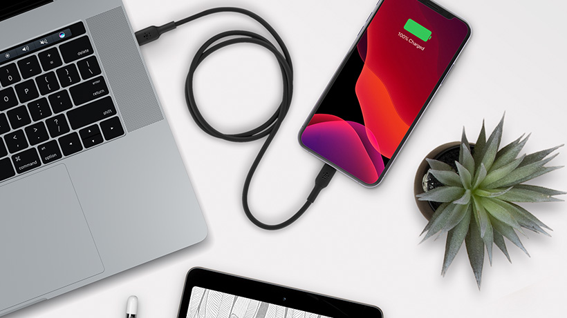 Belkin Boost↑Charge Cable charging an iPhone with a Mac laptop