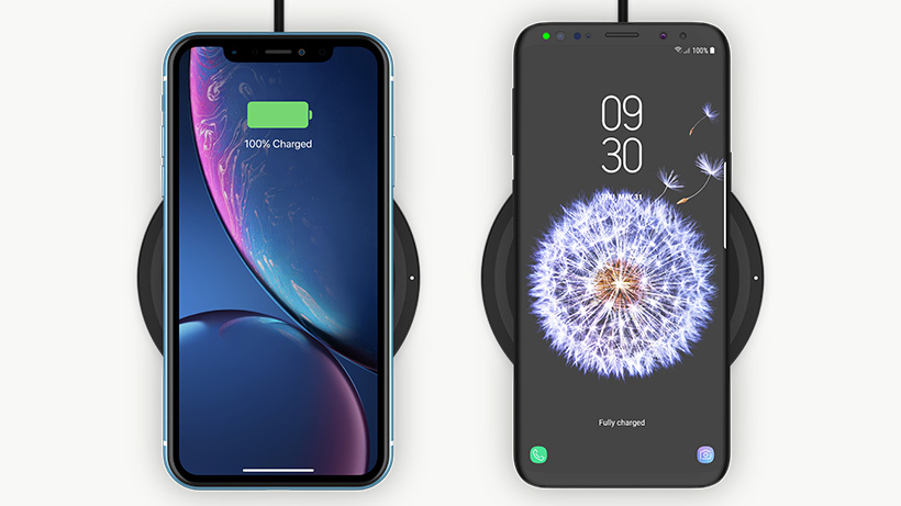 Two different phones being charged on the wireless charging pad