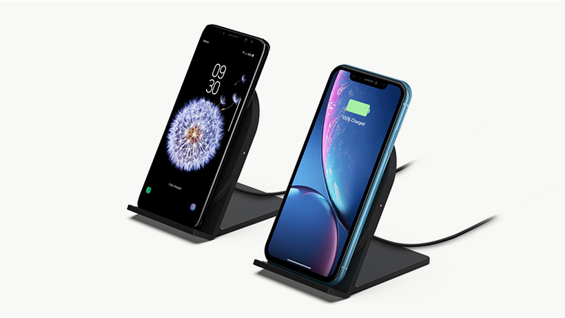 Two stands charging an iPhone and a Samsung smartphone