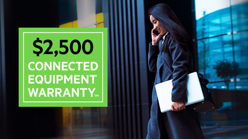Photo of a woman on the phone with $2,500 Connected Equipment Warranty icon overlaid