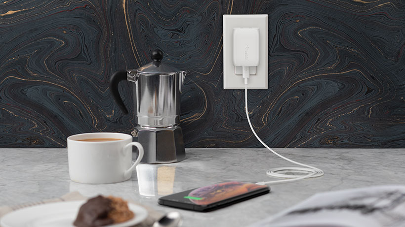 BOOST↑CHARGE USB-C Wall Charger powering iPhone in a kitchen