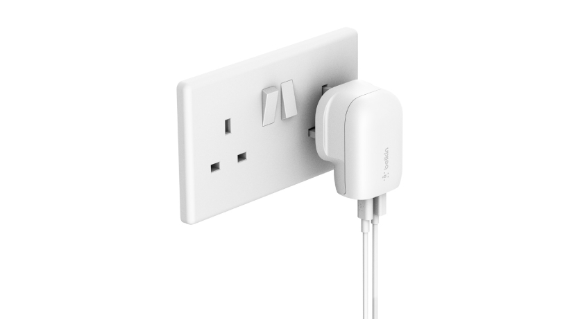 BOOST↑CHARGE Wall Charger being plugged into a wall outlet