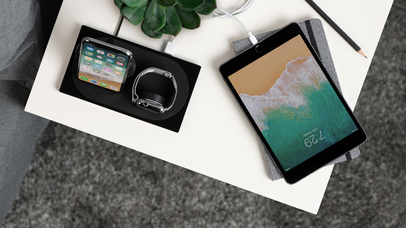 Dock charging an iPhone, Apple Watch simultaneously