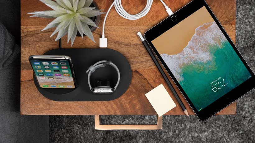Dock charging an iPhone, Apple Watch, or AirPods