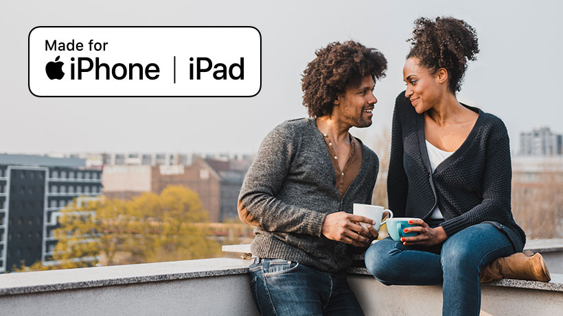 Photo of couple on a rooftop with iPhone/iPad compatibility icon overlaid