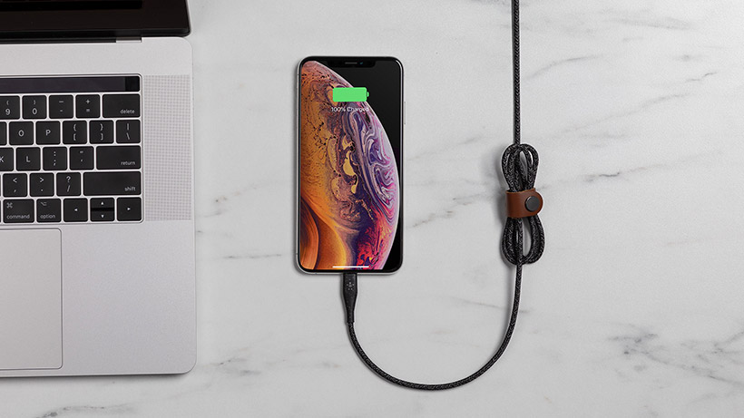 Strap holding excess cable while it is plugged into a smartphone