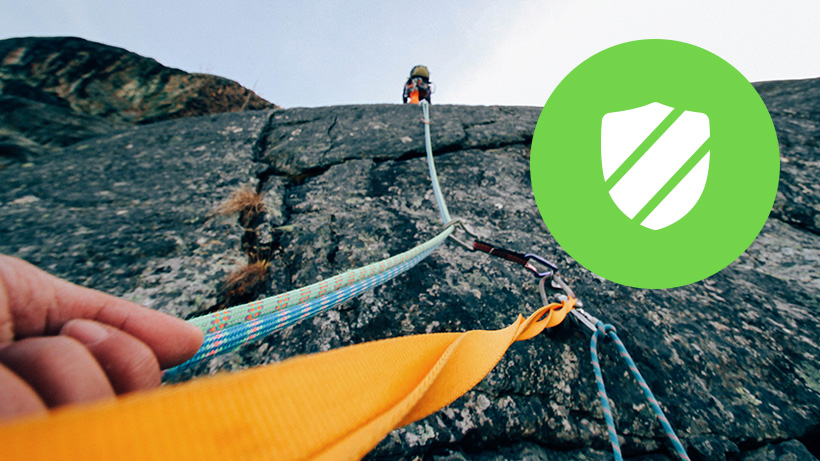 Shield icon overlaid on a photo of rock climbers