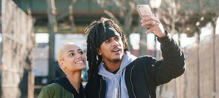 Couple taking selfie with iPhone