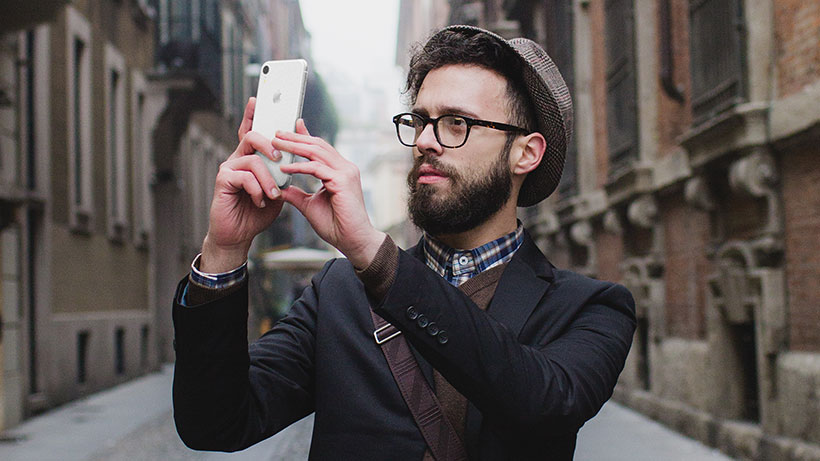 Man using his iPhone to take a picture