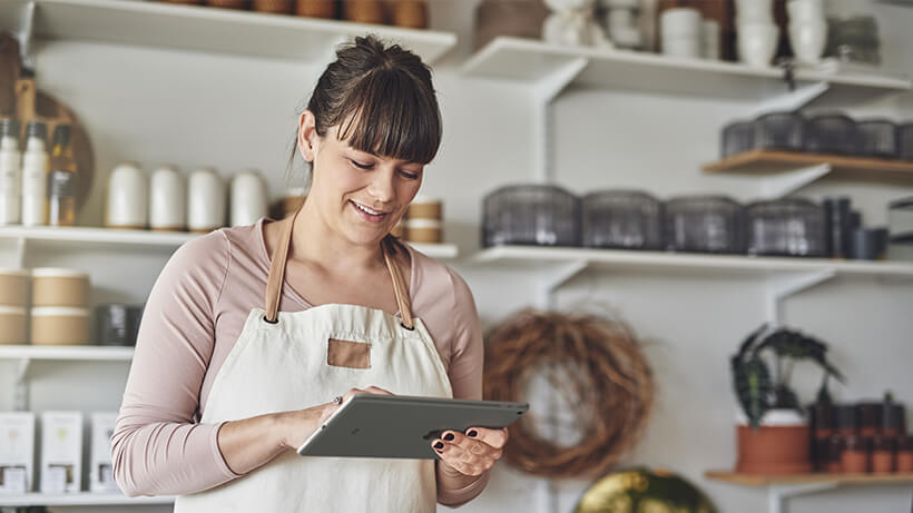 A woman using iPad 9.7 in her kitchen