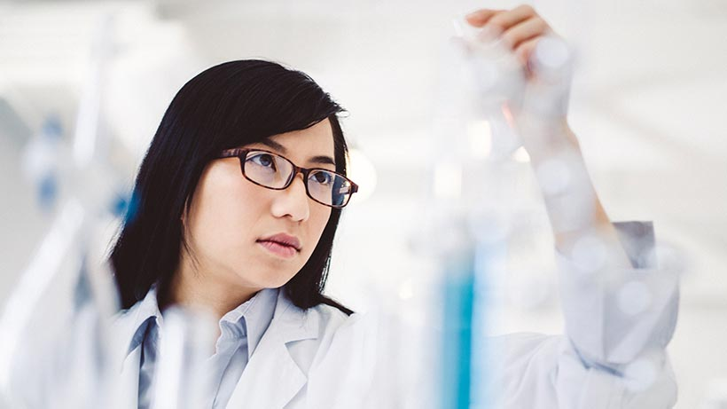 A woman working in a science lab
