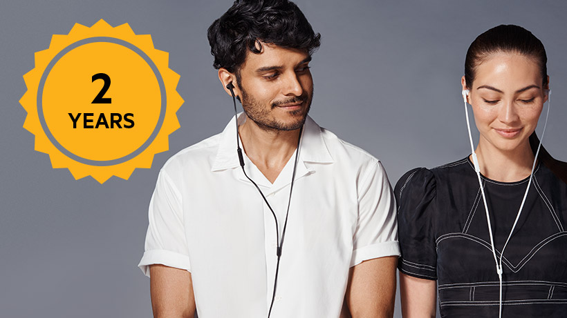 Photo of a couple with SOUNDFORM headphones with a 2-Year warranty icon overlaid