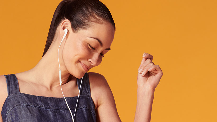 Woman snapping her fingers while listening to music