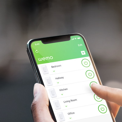 Closeup of person using the Long Press feature within the Wemo app.