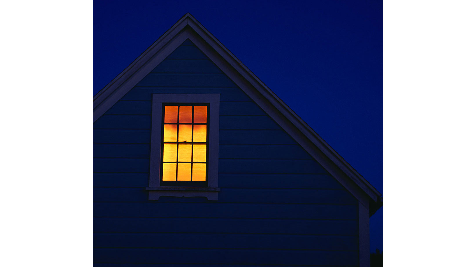Unoccupied house with lights on at night