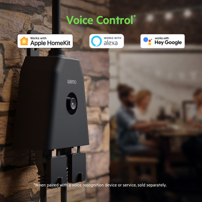 Wemo WiFi Outdoor Plug shown on wall next to Apple Homekit, Amazon Alexa, and Hey Google badges